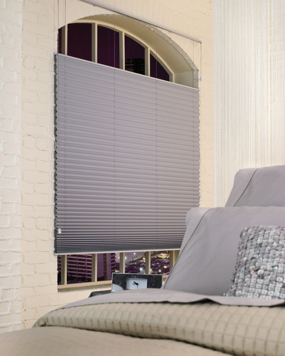 Pleated shades affordable blind services l l c for How to decorate an arched window